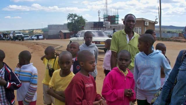 Kids with the bus driver at the Tanzanian-Kenyan border